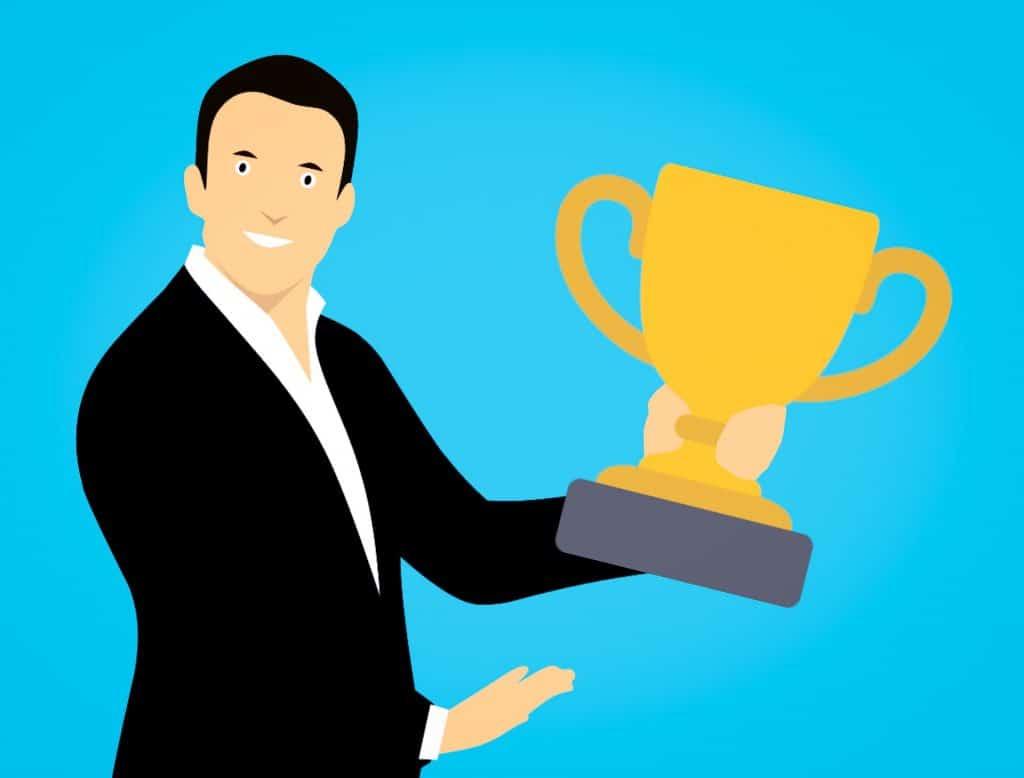 Cartoon of man holding a trophy