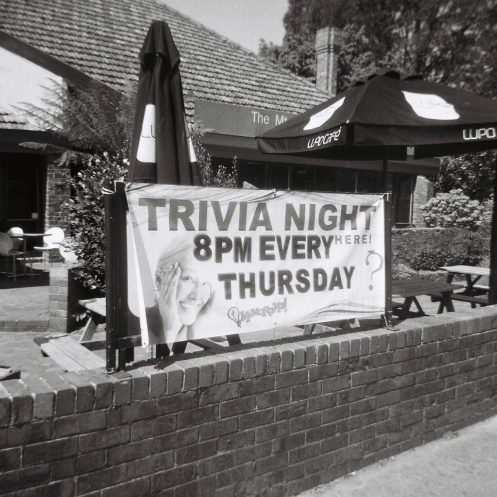 Trivia night advertisement outside a building