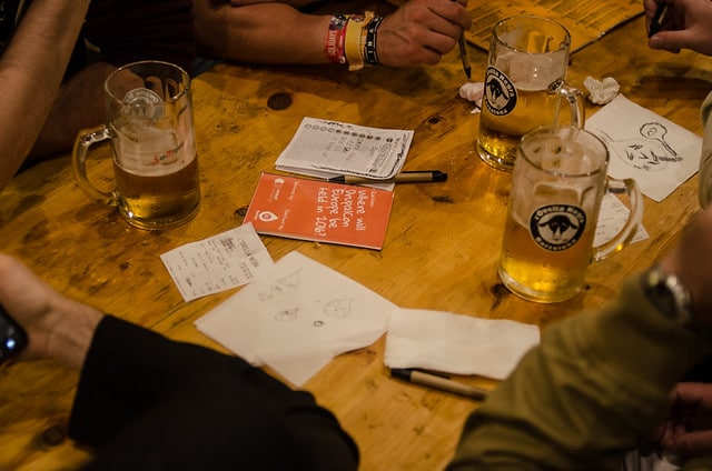 Trivia table with beers and questions