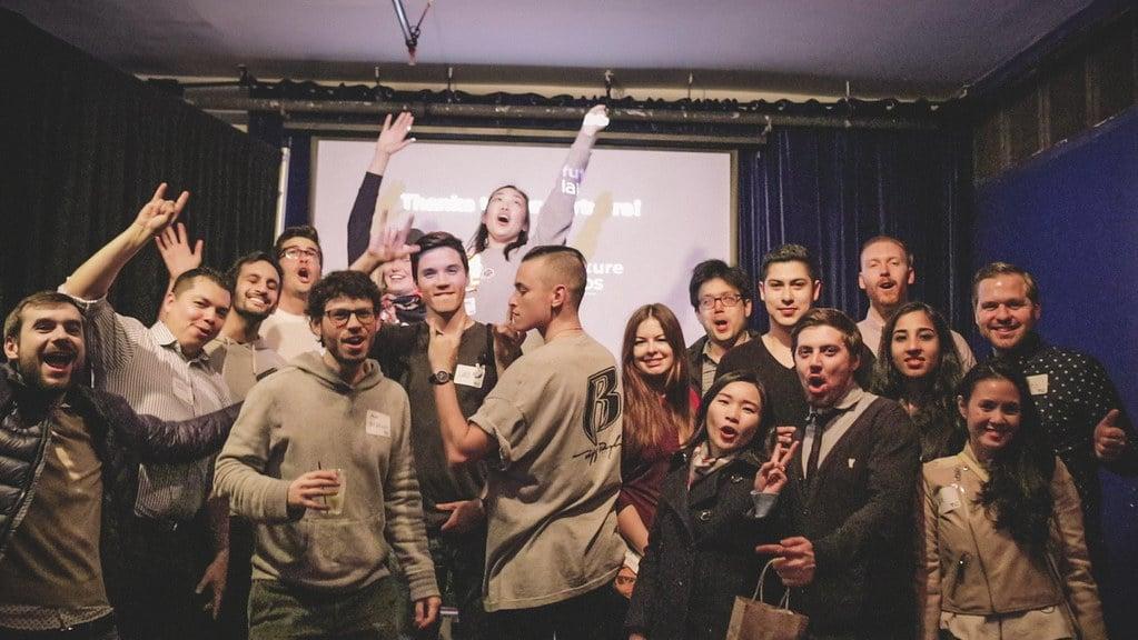Teams celebrating at a bar