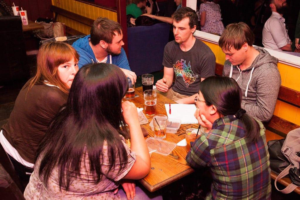A trivia team hard at work at a bar