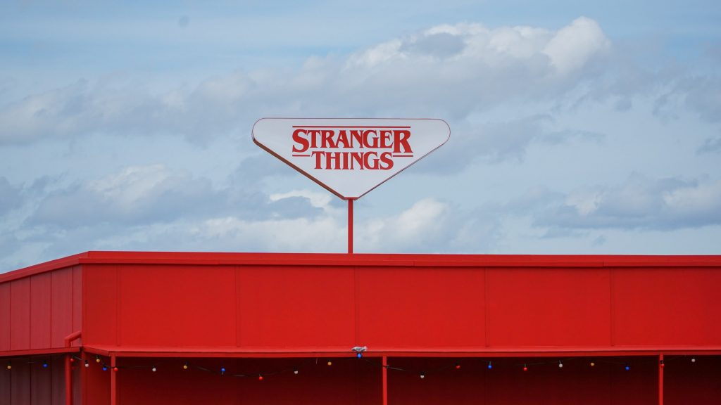 "A building with a ""Stranger Things"" sign on the roof"