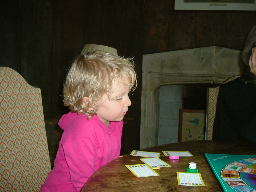 Child playing Trivial Pursuit