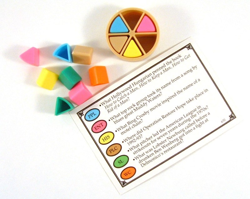 Classic Trivial Pursuit wedge, pieces, and question card.