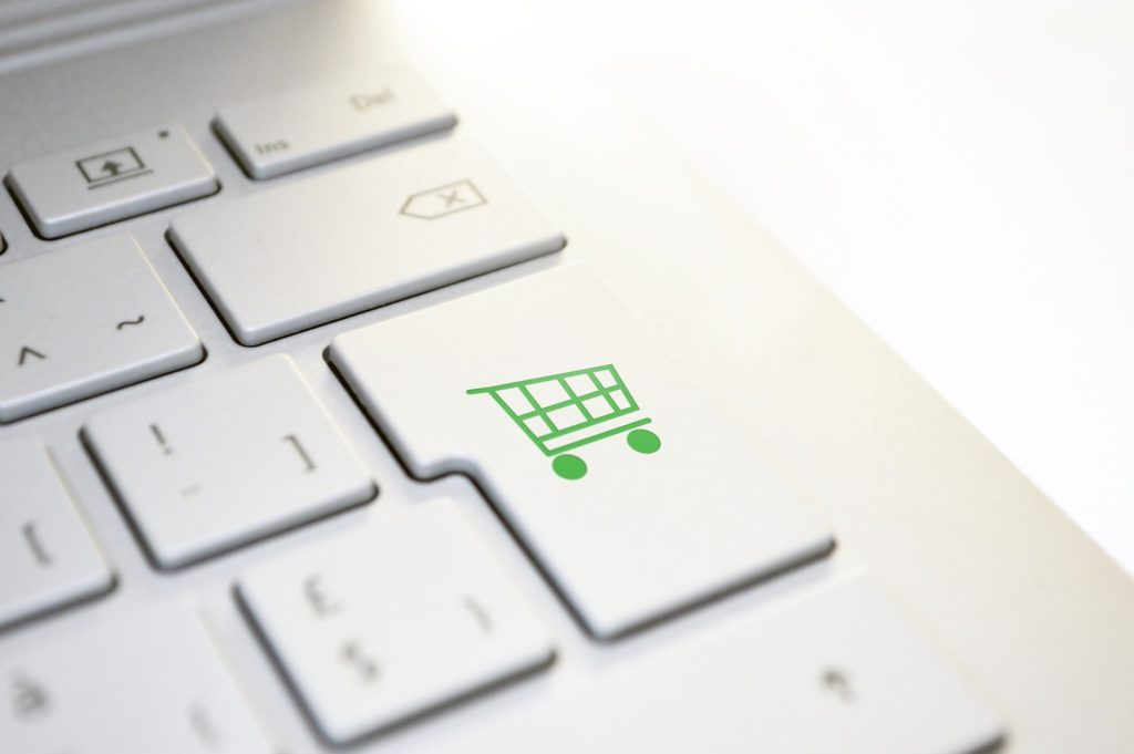 Keyboard with a shopping cart button.
