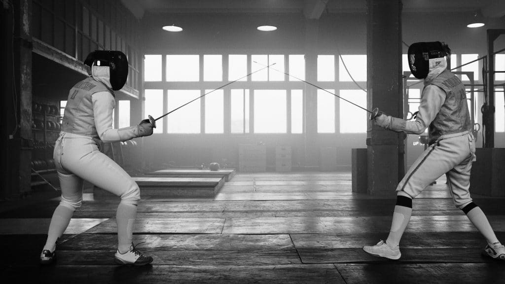 Two fencers face off in a duel