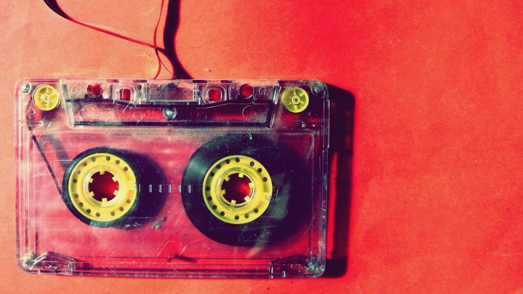 Music cassette on a red background.