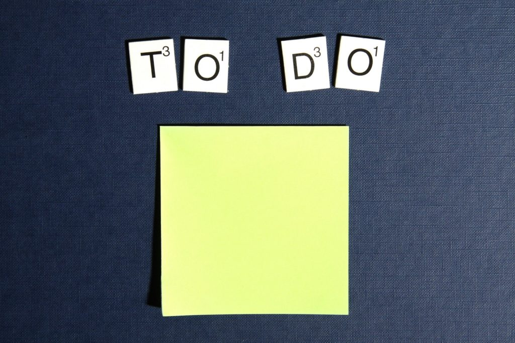 "Yellow sticky note with letters above it that spell out ""To Do"""