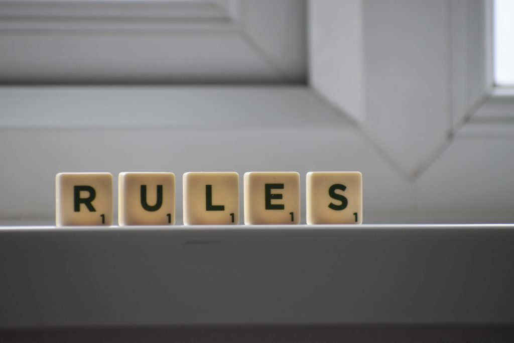 "Letters that spell out the word ""RULES"""