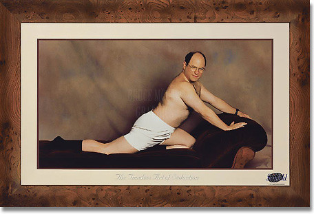 George Costanza (Jason Alexander) posing shirtless on lounge chair.