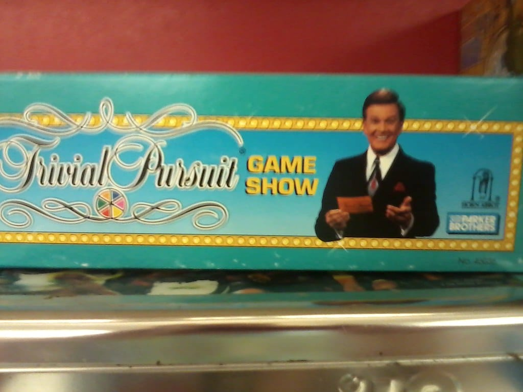 Side view of Trivial Pursuit Game Show board game box.