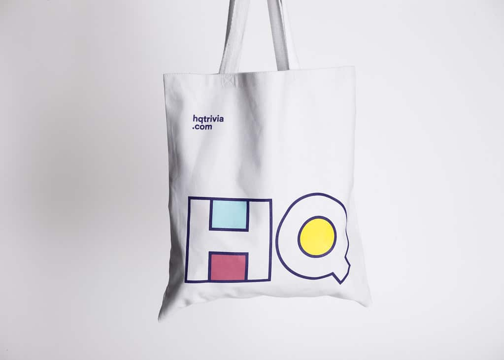 A tote bag featuring the HQ Trivia logo