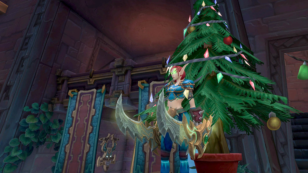 World of Warcraft character in front of a Christmas tree