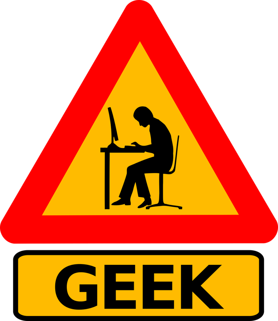 "A sign that reads ""GEEK"" with an image of a person typing on a computer"