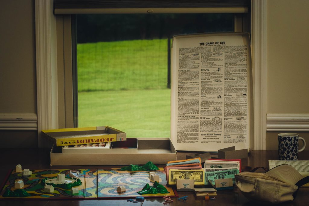 Retro games next to a window, including a classic Jeopardy board games.