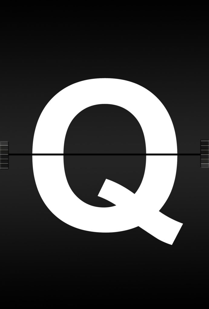 "The letter ""Q"" in white on a black background."