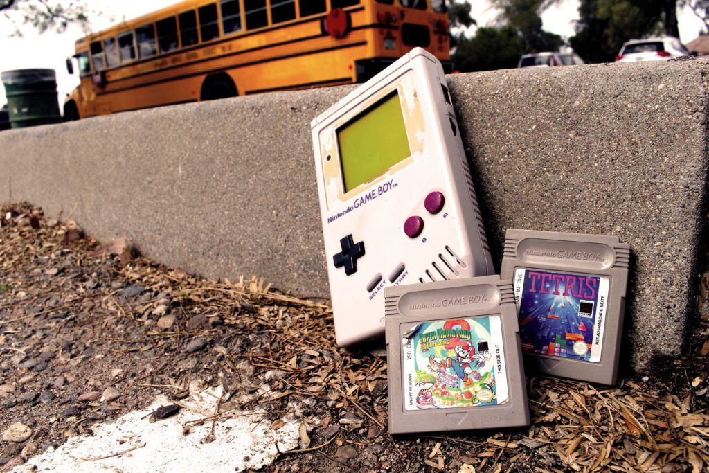 Close-up of Gameboy with Tetris and Super Mario Brothers 3 games.