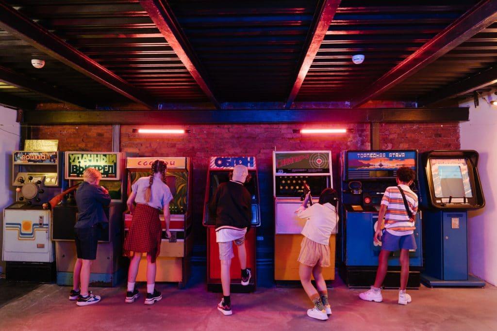 Kids playing various arcade games.