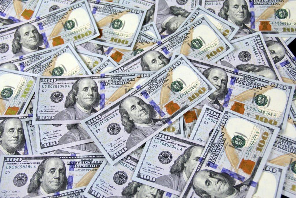 Close upon stacks of hundred-dollar bills (US).