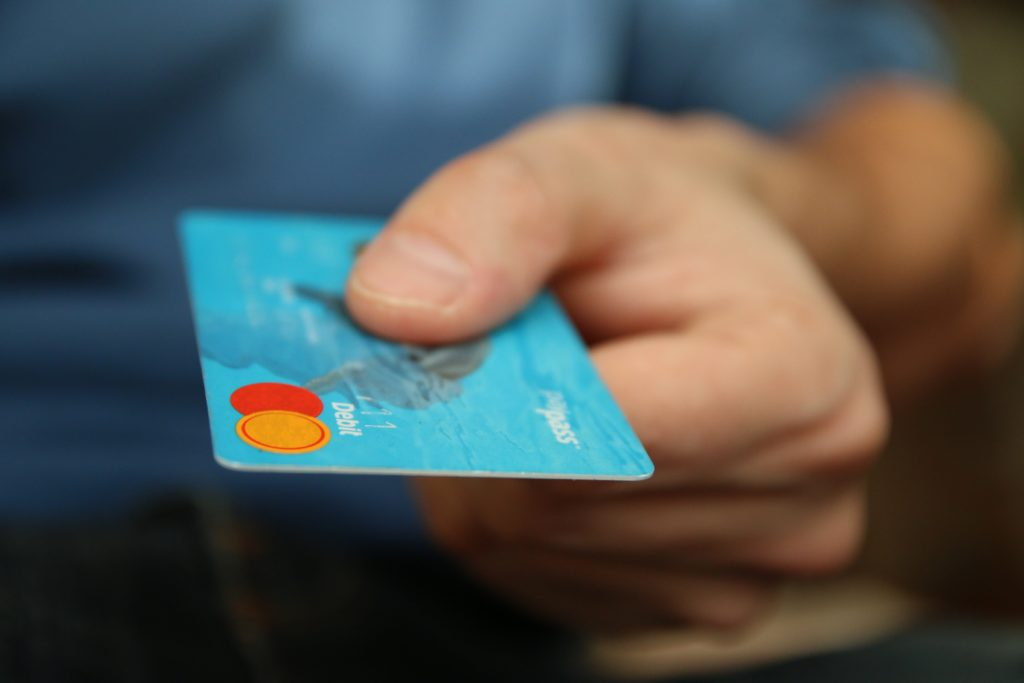Close up of a person holding a credit card.
