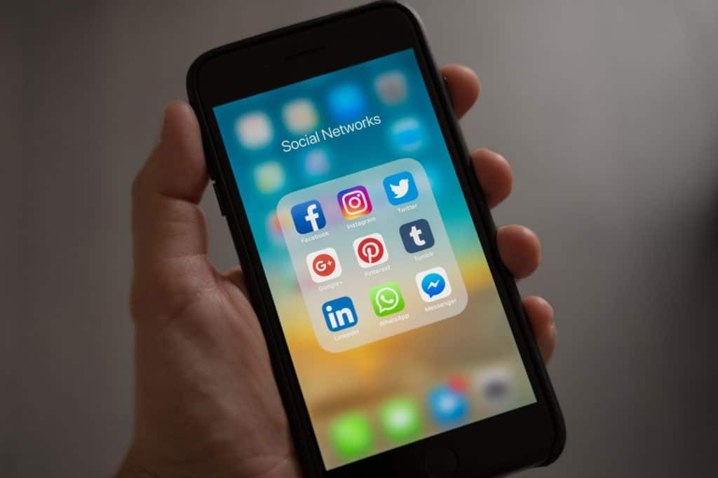 Close up a smart phone screen with social media apps.