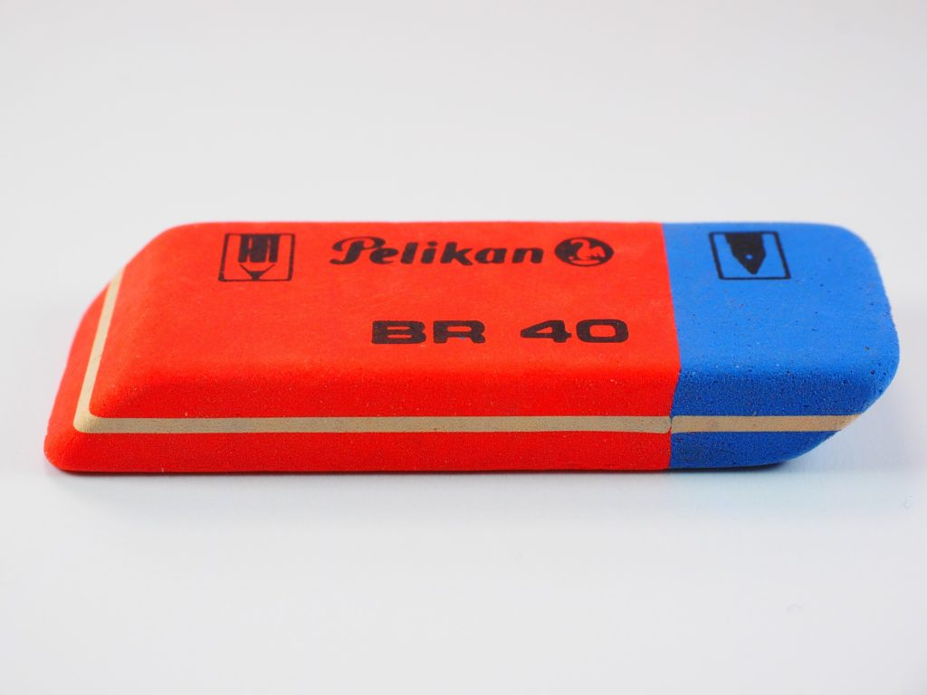 Close up of a red and blue eraser