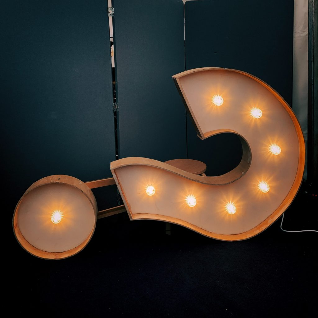 Lit up question mark sign