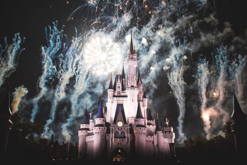 Fireworks outside the Disneyland Magic Kingdom at night.