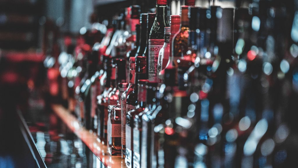 Close up of bottles on a bar