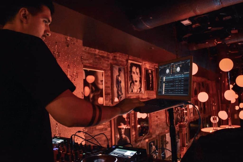 DJ performing at a bar.