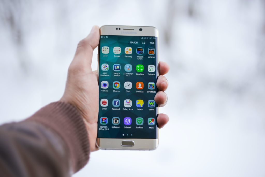 Person Holding Silver Android Smartphone