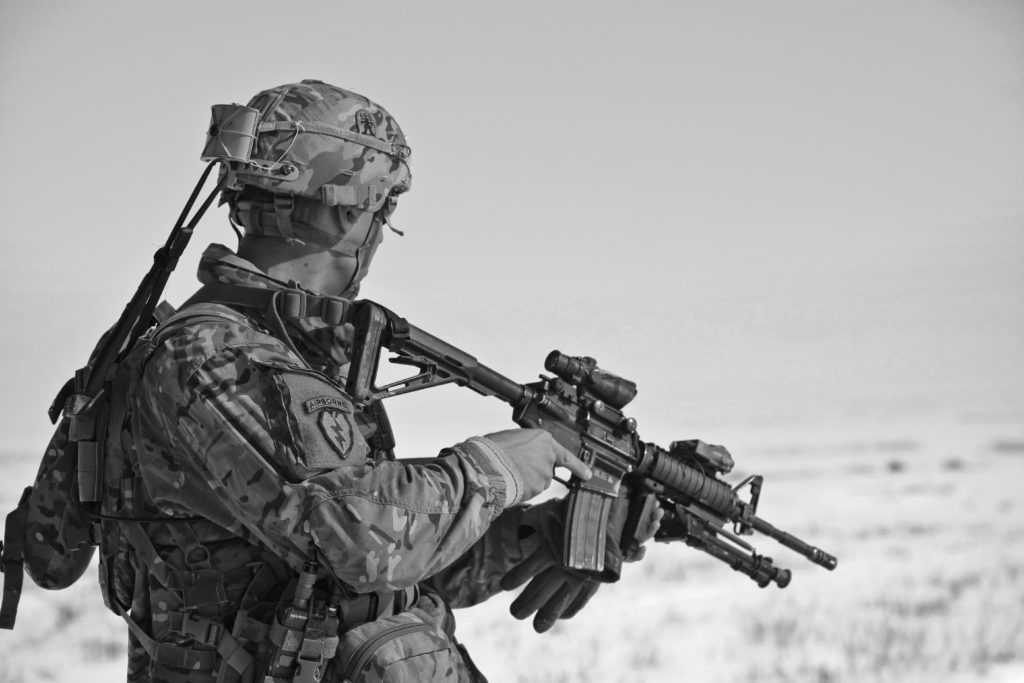 Black and white photo of a soldier in battle.