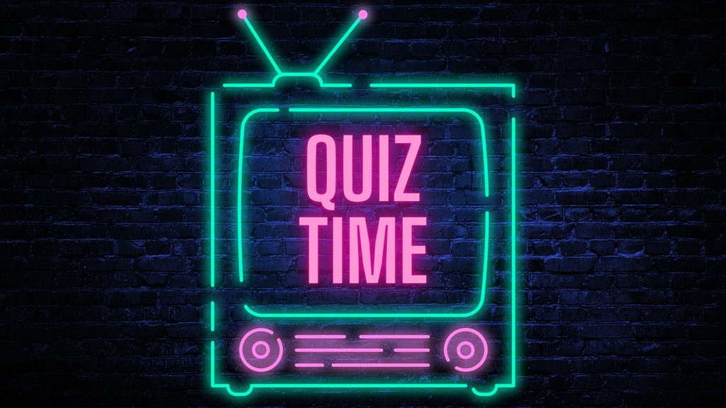 "Neon TV that says ""Quiz Time"" on it"