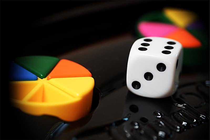 Close up of Trivial Pursuit dice and pieces.