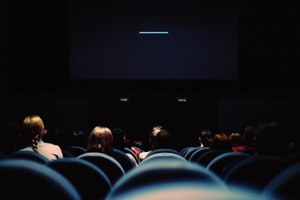 People in a dark movie theater.