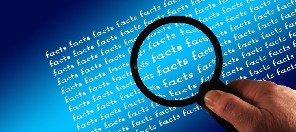 """Magnifying glass over the word """"facts"""""""