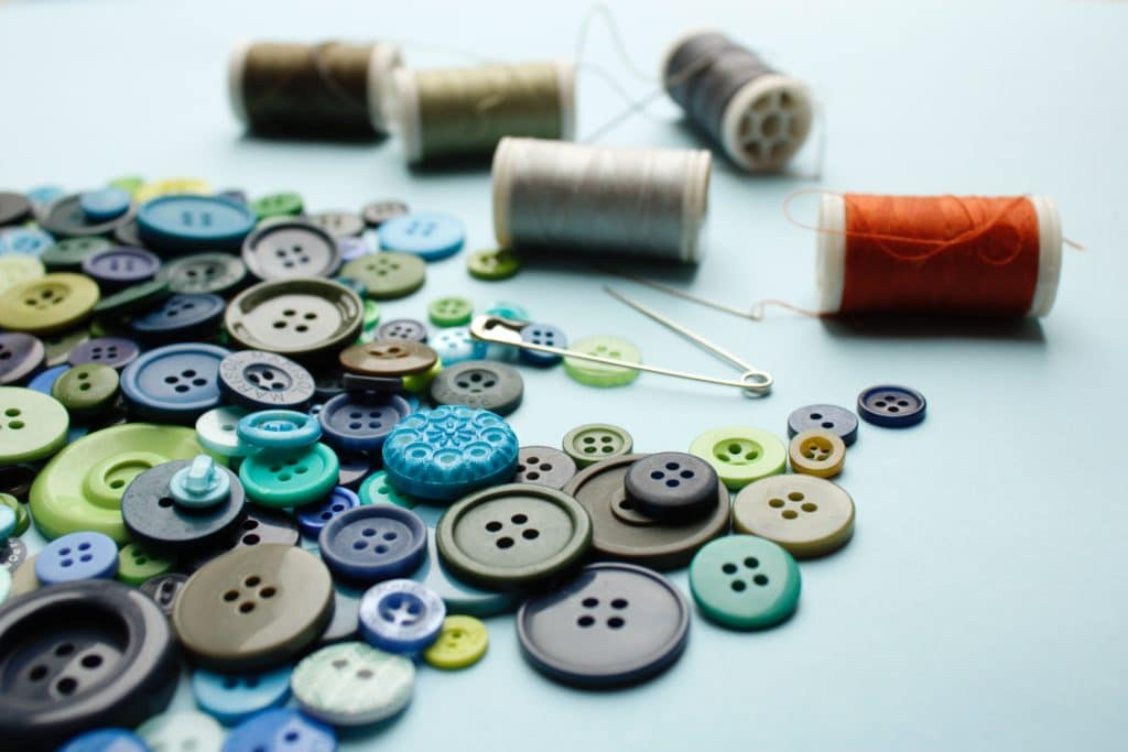 Buttons, spools of thread, and needles.