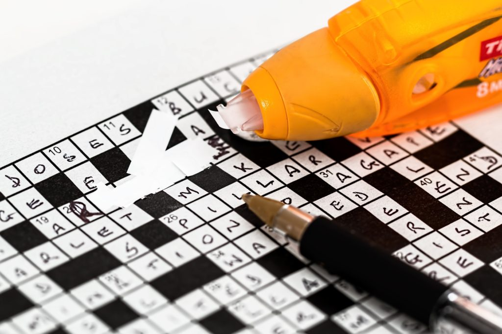 WhiteOut being used on a crossword puzzle.