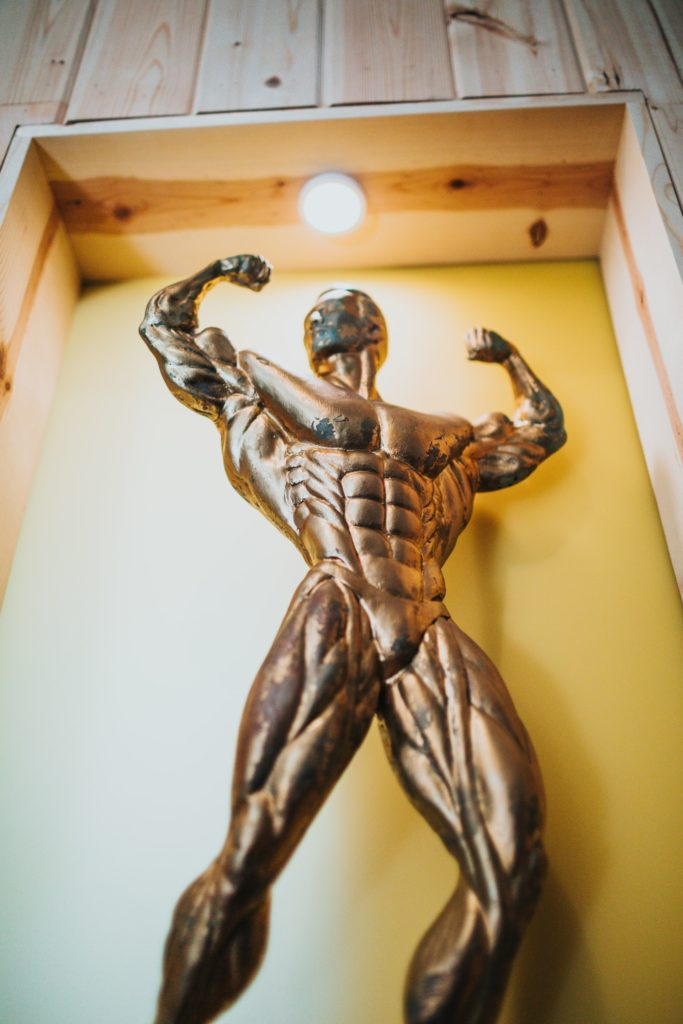 Golden statue of a bodybuilder.