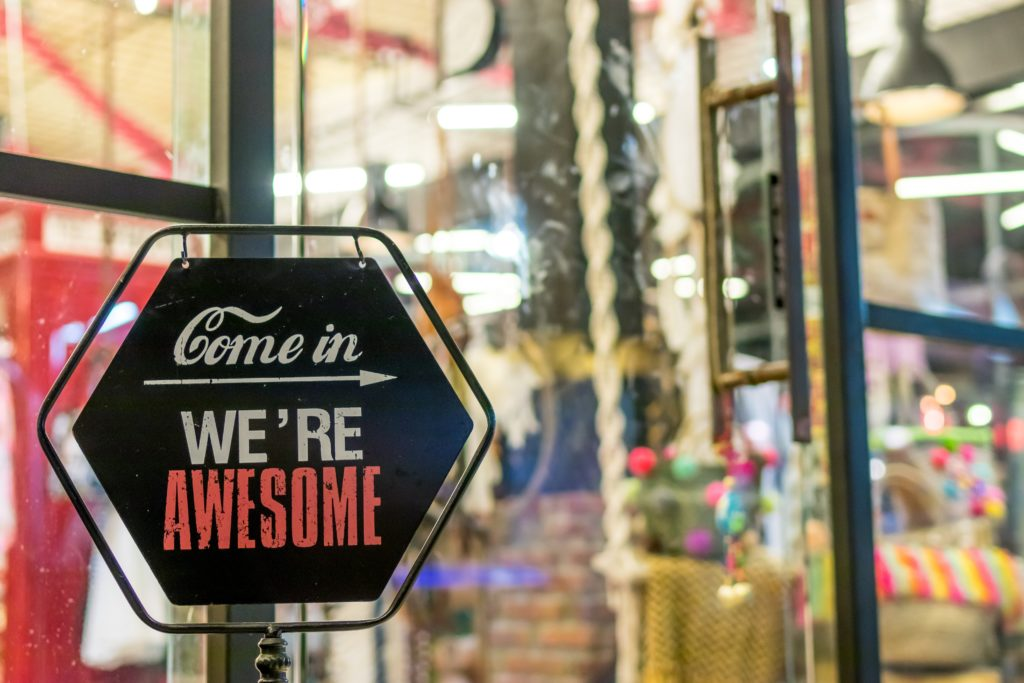"""A sign that reads """"Come in, We're Awesome"""""""