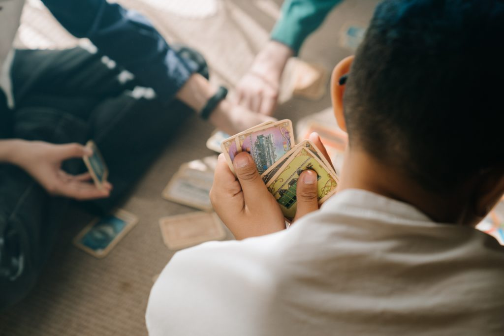 Man cheating while playing cards.