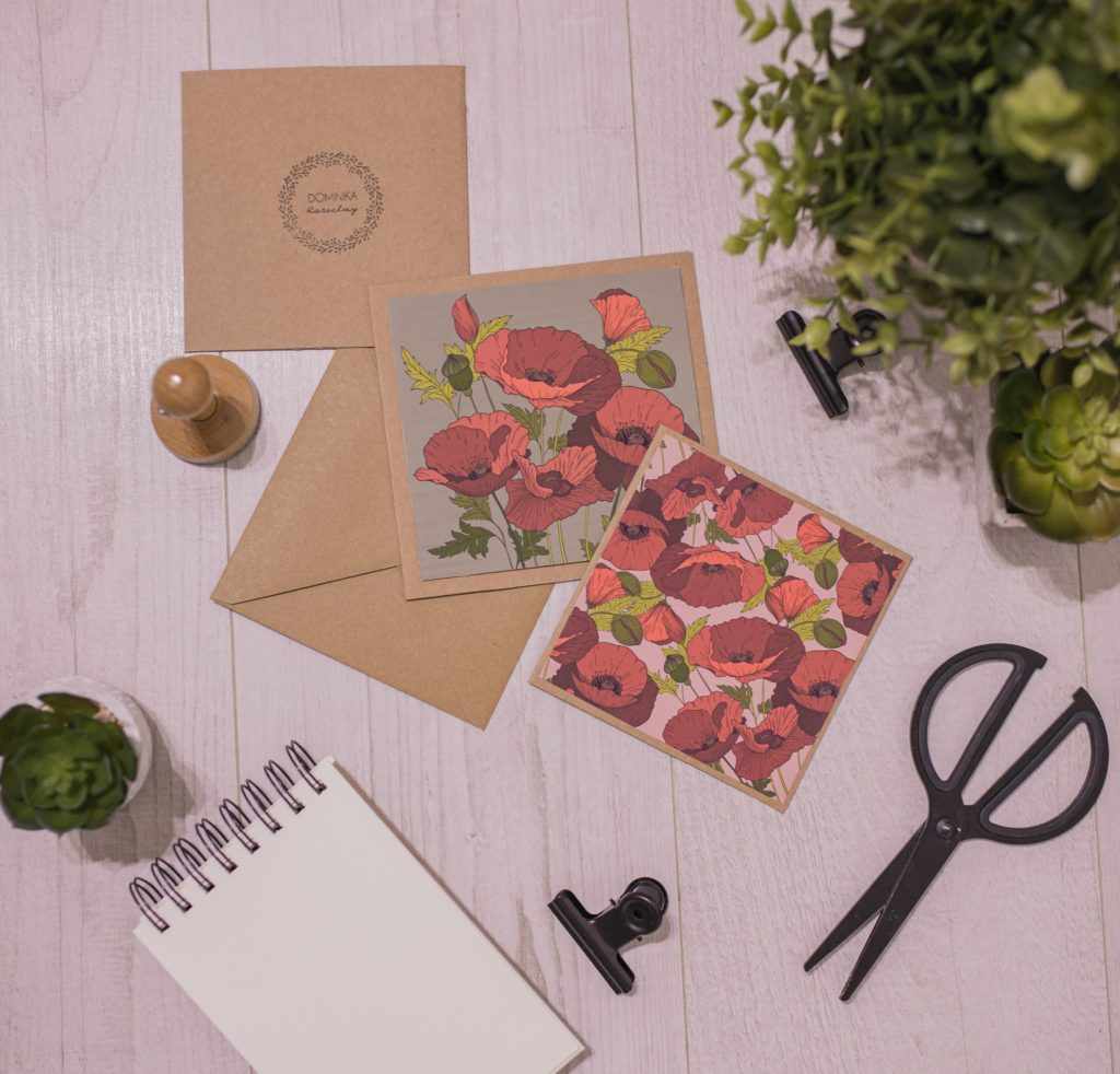 Invitations with flowers on them and an envelope stamp.