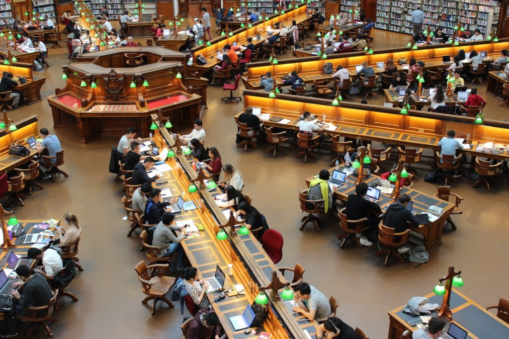 People studying in a high school library.