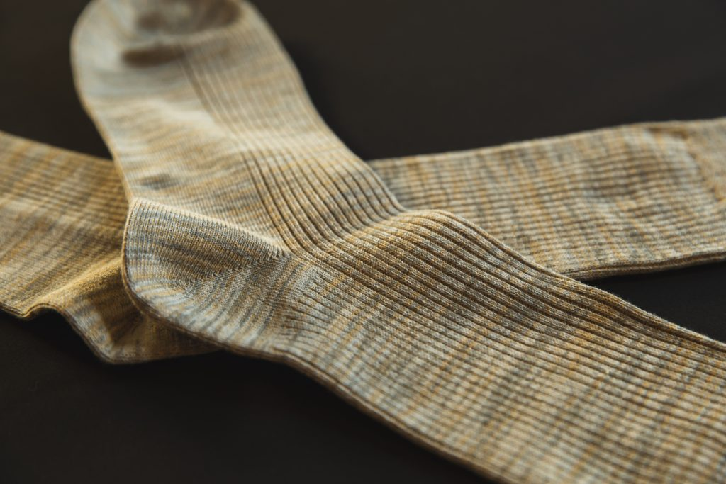 Close up on a pair of beige socks.