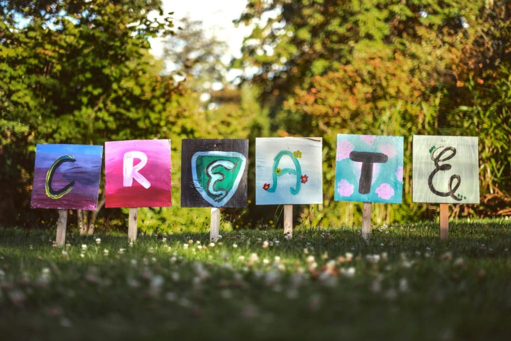 """Colorful signs spelling out the word """"CREATE"""""""