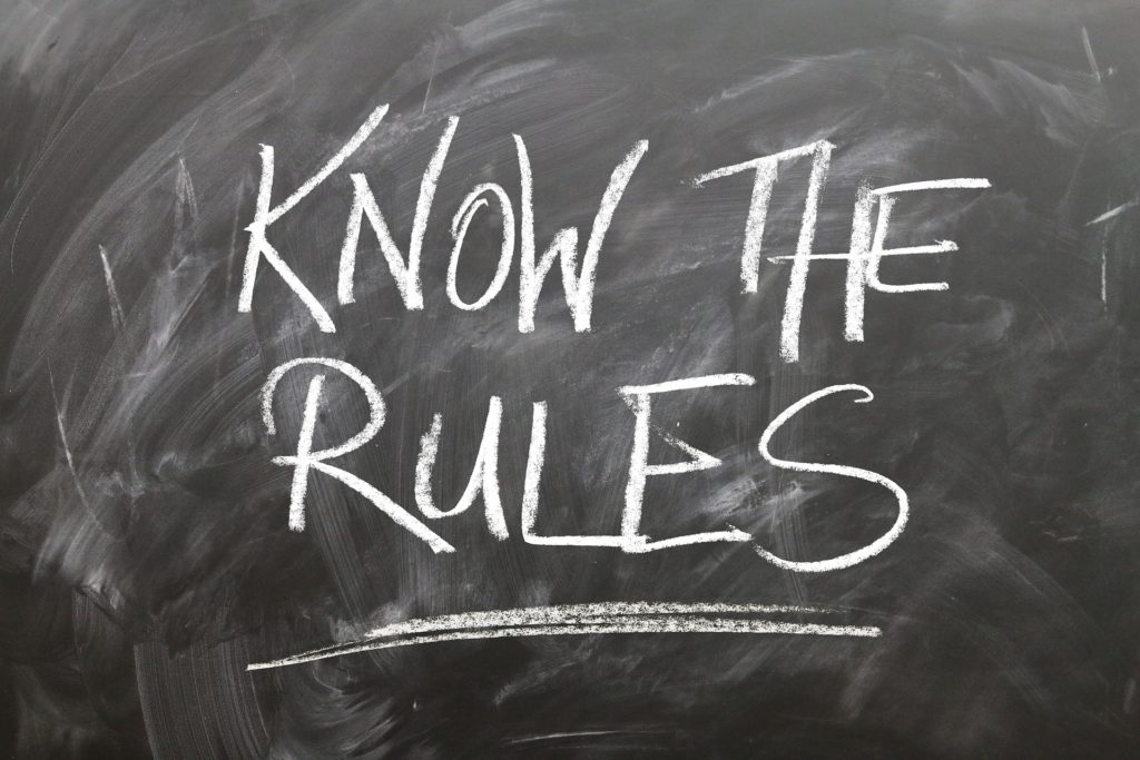 """Chalkboard with """"Know the Rules"""" written on it in chalk."""