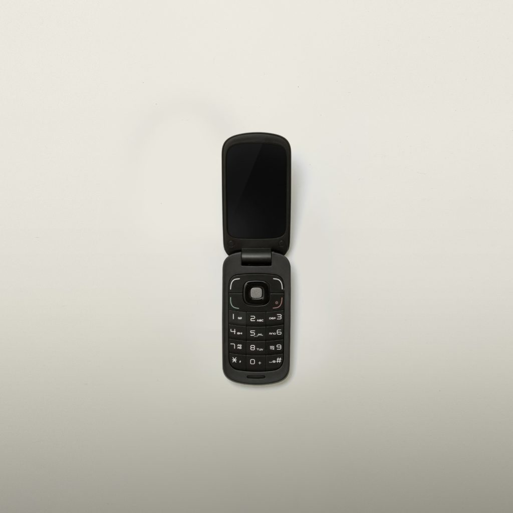 Close up of a black flip phone.