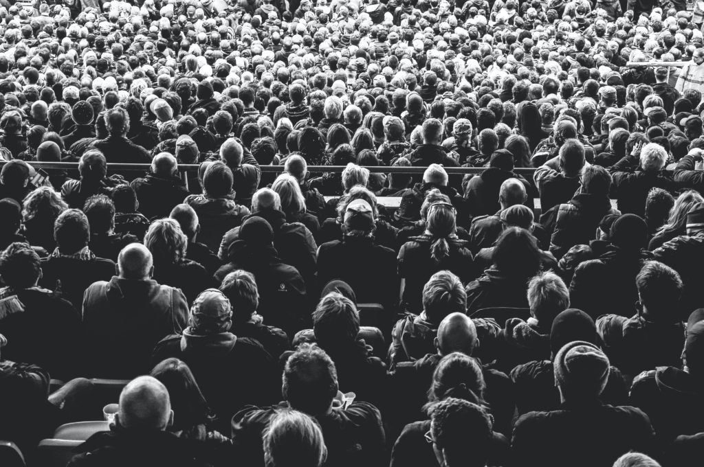 Black and white photo of an audience.