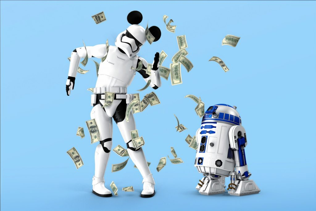 C3PO dancing for R2-D2, who is throwing money at him.