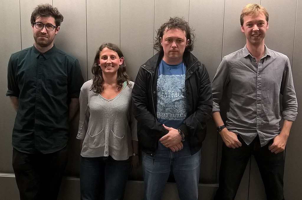 Four of the QI elves (researchers), and presenters of No Such Thing as a Fish (left-to-right); Dan Schreiber, Anna Ptaszynski, James Harkin and Andrew Hunter Murray, via Wikimedia Commons.